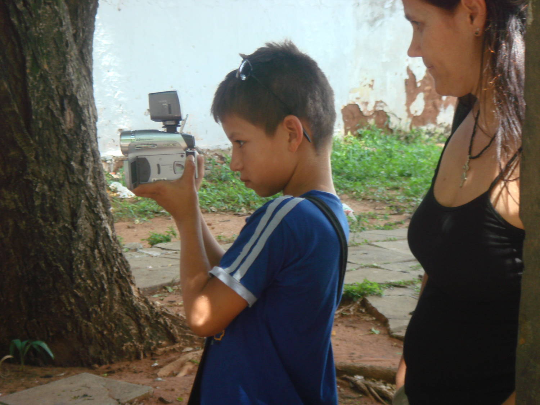 Shine a Light - Project Escuela de Cine Guaraní - Rita helping boy filming